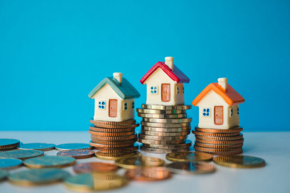 Miniature colorful house with stack coins