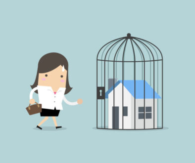 Businesswoman with locked house inside the cage, home foreclosure.