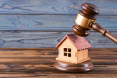 wooden house, judge's gavel on wooden background