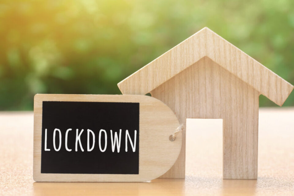 Wooden house and the inscription Lockdown. Coronavirus pandemic infection COVID-19. Isolation of people. Obstruction of the spread of the virus. Self-isolation. Confinement, quarantine